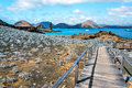 Galapagos islands view of walkway on bartolome island with pinnacle rock in the background in the in ecuador Stock Images