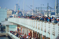 Galata bridge with fishermen angling from it istanbul turkey may and crowds of tourists Royalty Free Stock Photos