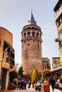 Galata tower christea turris in istanbul turkey april with tourists on april it s a medieval stone the karakoy quarter of Royalty Free Stock Image