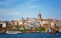 Galata tower and a seagul flying in the blue sky view of passage gold horn beyoglu s region Royalty Free Stock Photos