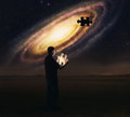 Galaxy puzzle piece a man holds a glowing from the Royalty Free Stock Photo