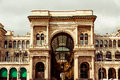 Galleria vittorio emanuele in milan outside view during cloudy day Royalty Free Stock Image