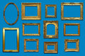 Gallery wall with gold frames old antique picture drop shadow on a blue background Royalty Free Stock Photos
