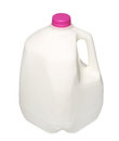 Gallon milk bottle with pink cap isolated on white background Stock Photo