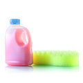 Gallons bottle of pink liquid with sponge Royalty Free Stock Images