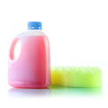 Gallons bottle of pink liquid with sponge Royalty Free Stock Photography