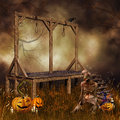 Gallows pumpkins and a zombie halloween scenery with monster Royalty Free Stock Images