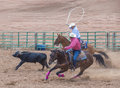 Gallup indian rodeo new mexico august cowboys participates in in a calf roping competition at the nd annual in nm on august Stock Photography
