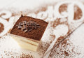 Galss of tiramisu glass on wooden white table Stock Photos