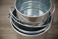 Galvanized buckets stack of empty close up on rustic wooden background Royalty Free Stock Image