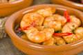 Gambas pil pil sizzling prawns with chili and garlic traditional spanish tapas dish Royalty Free Stock Photo