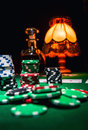 Gamble background poker chips cards and bottle of cognac Royalty Free Stock Photography