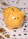 Gamble to save money piggy bank studio cutout Royalty Free Stock Images
