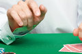 Gambler male hand with cards and chips on green table Royalty Free Stock Photography