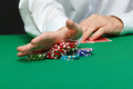 Gambler male hand with cards and chips on green table Stock Images