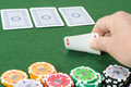 Gambler a play some fiches in poker game Stock Image