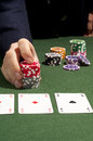 Gambler a play some fiches in poker game Royalty Free Stock Photo