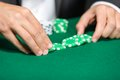 Gambler puts the chips on the table Stock Photography