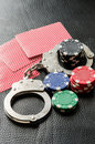 Gambling addiction concept image with handcuffs Royalty Free Stock Photo