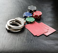 Gambling addiction concept image with handcuffs Royalty Free Stock Photos
