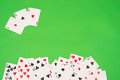 Gambling background poker cards on a traditional green Royalty Free Stock Photo