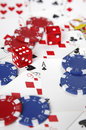 Gambling cards, chips and dice with shallow focus. Royalty Free Stock Images