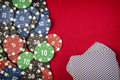 Gambling chips and card deck for poker on red felt background Royalty Free Stock Photo