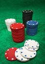Gambling chips over green felt Royalty Free Stock Images