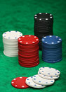 Gambling chips over green felt Stock Photography