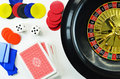 Gambling concept with cards roulette dice and chips Royalty Free Stock Photography