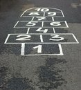 Game on asphalt the hopscotch for children in yard Stock Images