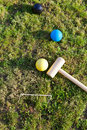 Game of croquet on green lawn top view balls and mallet for in summer day Royalty Free Stock Photos