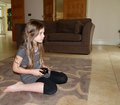 Game face utter concentration girl playing games on the tv using a hand held controller Royalty Free Stock Image