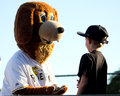 Game of fetch riverdogs mascot charlie and a young fan play a before time Royalty Free Stock Photography