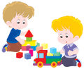 Game little boys playing with a toy truck and bricks Royalty Free Stock Image