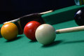 Game of pool closeup in action with red ball about to be hit in middle pocket Stock Images