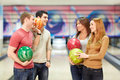 Game smiling young people in bowling Royalty Free Stock Images