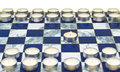 Game started first move burning candle chessboard Stock Photo