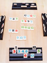 Gameplay of rummikub board game moscow russia march was invented by ephraim hertzano in the early s Royalty Free Stock Photo