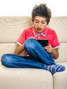 Gamer boy with tablet pc having fun preoccupied expression isolated on white Royalty Free Stock Images