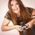 Gamer woman holding gaming pad Royalty Free Stock Photo