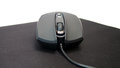 Gaming mouse on pad on white background Stock Photo