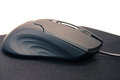 Gaming mouse on pad on white background Royalty Free Stock Images