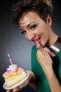 Gamour girls her cake Royalty Free Stock Images