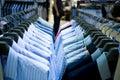 Ganchos de pano com camisas Imagens de Stock Royalty Free