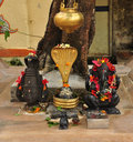 Ganesh and a devi statue. Small Indian worship shrine Royalty Free Stock Photo