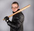 Gangster with a bat in glass holding black jacket Royalty Free Stock Image