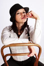 Gangster-girl sitting on chair Royalty Free Stock Photography