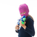 Gangster girl wearing a mask holding a water gun Stock Photos