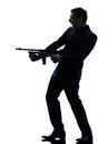 Gangster man holding thompson machine gun silhouette Royalty Free Stock Photo